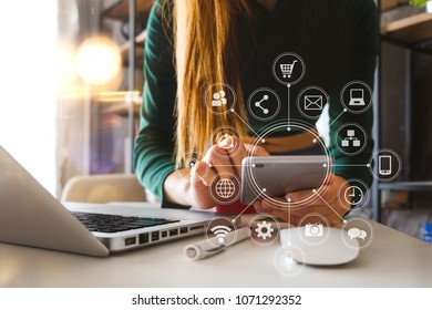 businesswoman or Designer using smart phone with laptop and digital tablet computer and document on desk in modern office with virtual interface graphic icons network diagram