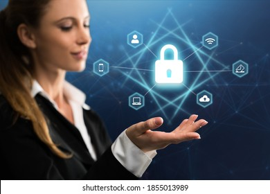 businesswoman with digital interface showing devices around a lock symbol on abstract background