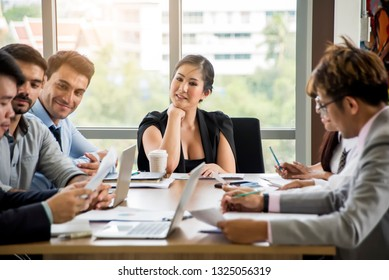 Businesswoman discussing company indicators with male business partner at meeting in office. Female financial consultant, credit expert explaining terms of contract to client or investor