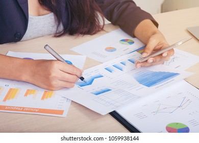businesswoman  discussing market research looking at documents or spreadsheet at her working place.business meeting concept