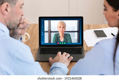 Businesswoman discussing working plan with colleagues through video conference. Group of business people using laptop computer in office for online meeting and virtual communication, creative collage