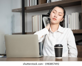 A businesswoman doing a neck massage to relieve fatigue after finishing an online meeting with coworkers while working at home.