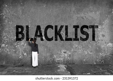 businesswoman drawing blacklist on the wall