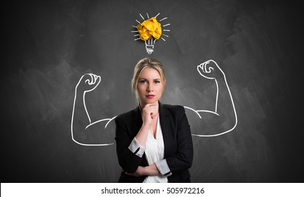 businesswoman with drawing symbolizing power and having an idea