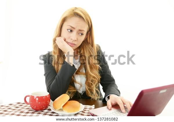 Businesswoman eating food