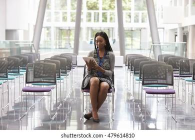 Businesswoman In Empty Auditorium Preparing To Make Speech