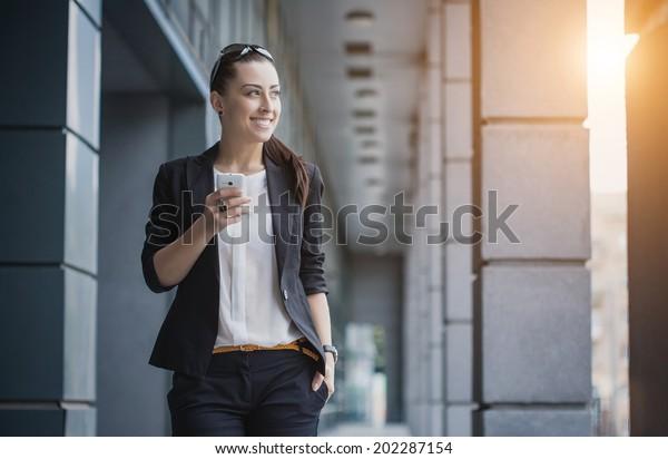 businesswoman or entrepreneur talking on cellphone. City businesswoman working.