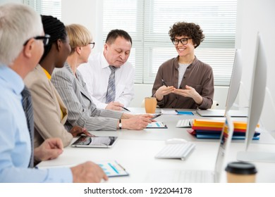 Businesswoman explains to colleagues a new project in the modern office