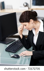 businesswoman feeling stressed out at work