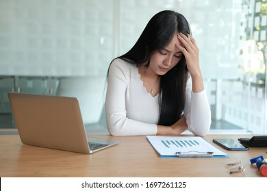 businesswoman feeling tired, frustrated & stressed from hard work. exhausted woman  freelancer have headache at workplace.