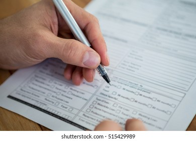 Businesswoman filling last will and testament form against white background