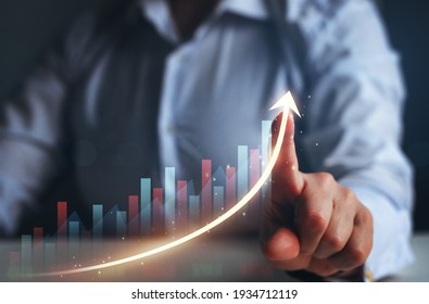 Businesswoman finger pointing arrow graph. Business development to success, profit and growing growth plan.