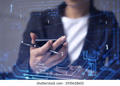 Businesswoman in formal wear holding in the hands a smart phone and testing an innovative application to provide a completely new service. Close up shot. Hologram tech graphs. Concept of Dev team. - Shutterstock ID 1935618652