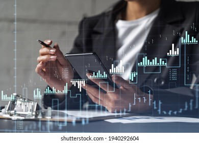 Businesswoman in formal wear is signing the contract to invest money in stock market. Internet trading and wealth management. Checking the details of transaction at smart phone. Forex