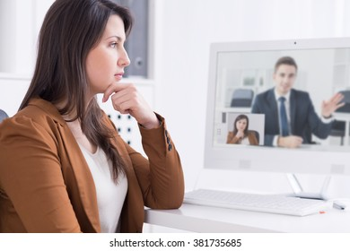 Businesswoman in front of computer, during video conference