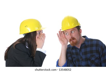 businesswoman gestures telling something to construction worker on workplace