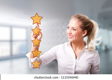 businesswoman giving a five star rating