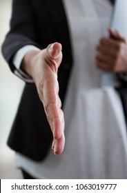 businesswoman giving hand to handshake