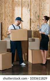 Businesswoman giving instructions to delivery man with box