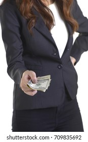 Businesswoman giving money(american dollars) for her business on white background, closeup