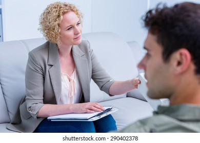Businesswoman giving paper tissue to her colleague in office
