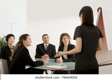 A businesswoman giving a presentation