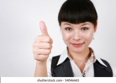 Businesswoman giving thumbs up for approval