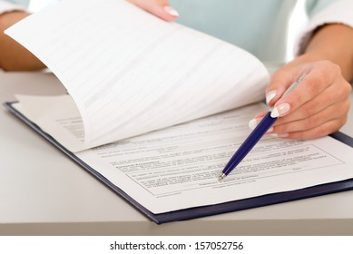 businesswoman giving you the pen and the contract to sign (isolated on white)