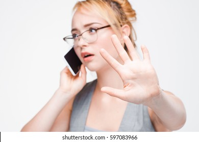 Businesswoman in glasses busy with important mobile phone call. Wait, don't interrupt or disturb.