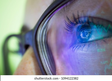businesswoman in glasses, the reflection in the glasses graphs, tables, sale