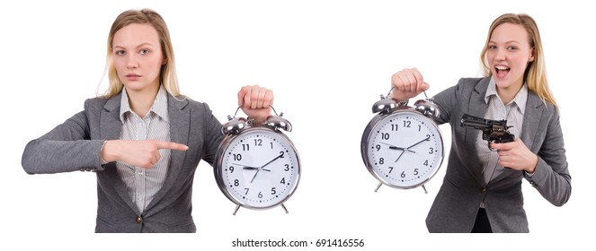 Businesswoman in gray suit holding alarm clock isolated on white