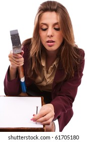 Businesswoman with hammer nailing a contract, conceptual shot