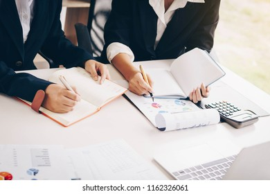 Businesswoman hand pen pointing on business document at meeting discussion and analysis data the charts and graphs showing the results at meeting.Business financial and accounting concept.