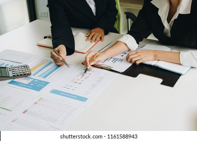 Businesswoman hand pointing pen on business document at meeting discussion and analysis data the charts and graphs showing the results at meeting.Business financial and accounting concept.