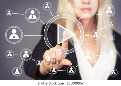 Businesswoman hand press web play button.