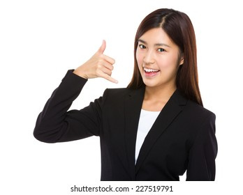 Businesswoman with hand show with call ma sign