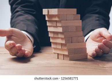 Businesswoman hand stopping risk the domino wooden challenge effect concept  management for business
