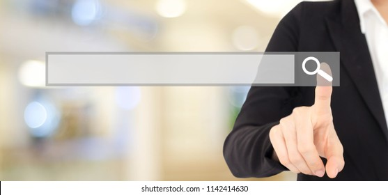 Businesswoman hand touching blank search bar over blur background, business and technology concept, search engine optimization, web banner