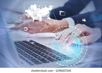 Businesswoman hand using laptop in office, businessman hand using smartphone with double exposure of business infographics and hud. Toned image. Elements of this image furnished by NASA
