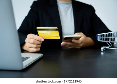 Businesswoman hand using mobile smart phone and creditcard, onlinepayment, banking and online shopping at the home office.