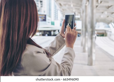 Businesswoman hand using stylus pen  on device or smartphone