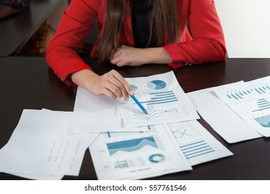 Businesswoman hand working with business graph or analysis chart. Close up business team analysis and strategy concept.