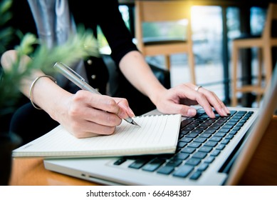 businesswoman hand working with finances about cost and calculator
