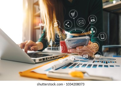 businesswoman hand working with laptop computer, tablet and smart phone in modern office with virtual icon diagram at modernoffice in morning light