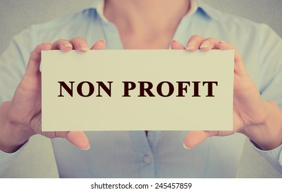 Businesswoman hands Holding Small White Sign card with Non Profit Text message