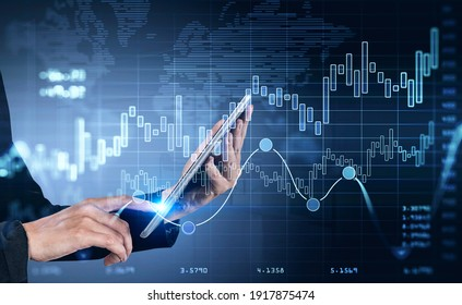 Businesswoman hands using tablet researching a business report of financial market behaviour based on worldwide news. Business and financial success concept. double exposure. World map on background