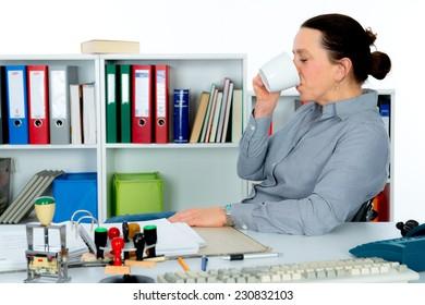 businesswoman has a little break on workplace