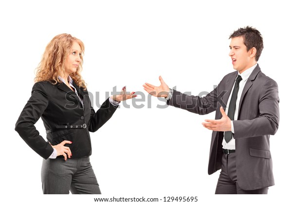 Businesswoman having an argument with a young businessman isolated against white background
