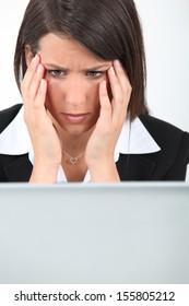 Businesswoman having computer problems