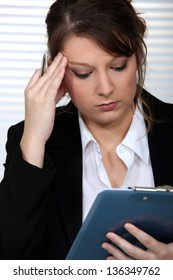 A businesswoman having a headache.